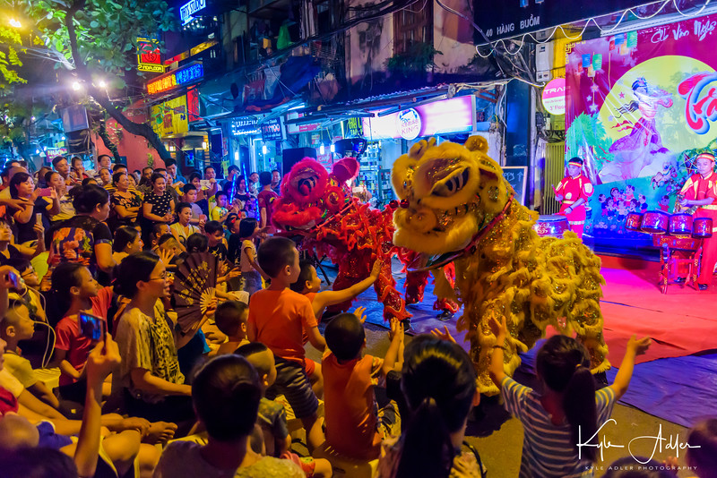 Lion dancers perform for the crowds in the days leading up to the harvest moon.