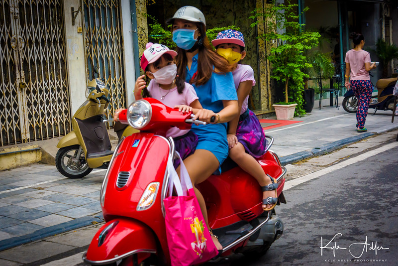 Motor scooters are the major form of transportation in Vietnam's cities.  Whole families of three, four, and even five people commonly share rides.