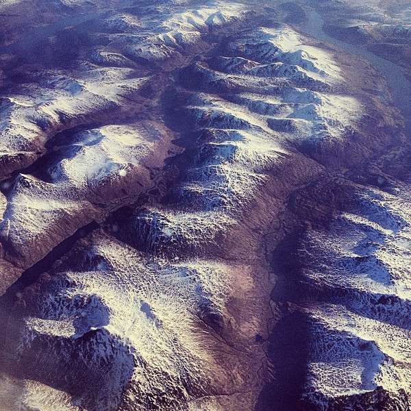 When you open your airplane window shade at first light: A dusting of snow on the Scottish Highlands #upintheair #earthfromabove
