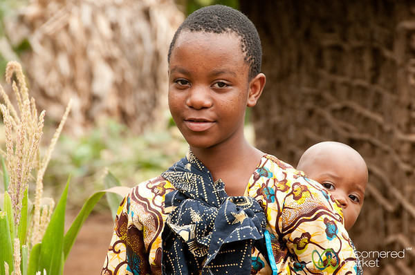 Girl Carrying Her Baby Brother - Mto wa Mbu, Tanzania