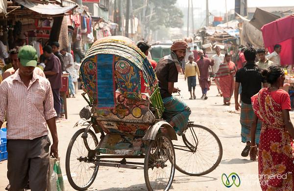 Rickshaw Driver in Typical Streetscene of Old Dhaka, Bangladesh