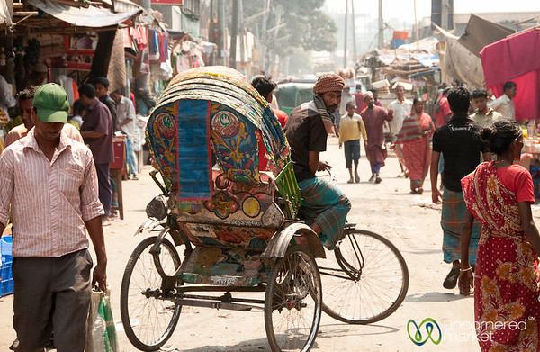Rickshaw Driver in Typical Streetscene of Old Dhaka, Bangladesh