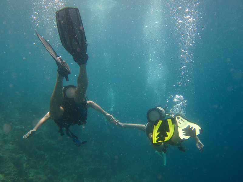Holding Hands While Diving around Menjangan Island - Bali, Indonesia