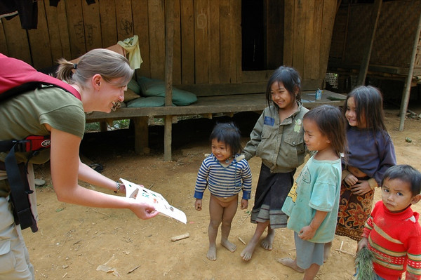 Handing Out a Book to Village Kids - Nong Khiaw, Laos