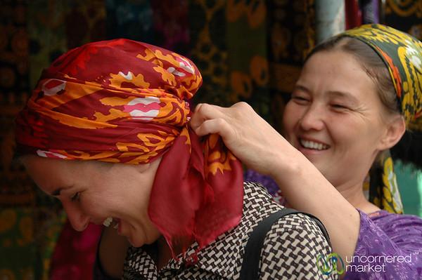 Woman Tying Head Scarf - Tolkuchka Market, Azerbaijan