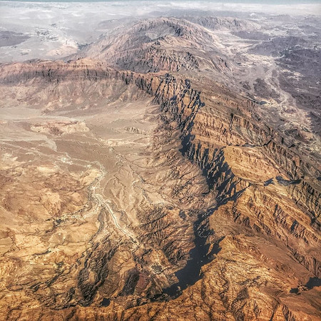 Up in the air, over the Al Hajar Mountains near Jabal Akhdar, Oman. I always enjoy those moments on a long-haul flight where I find myself astonished by a slice of landscape from above, and am again taken away in awe of our planet. Taken on the Abu Dhabi to Sydney leg of a marathon travel day that began in Berlin. via Instagram http://ift.tt/1Ua6VRM