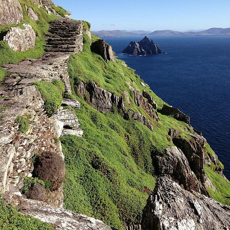 Happy St. Patrick's Day! This is a shot from one of my all-time favorite places, the island of Skellig Michael off the western coast of Ireland and County Kerry. The island is known for consistently poor weather. The day we visited, the seas were almost eerily placid and the sky cloudless. Stone walls and stairs and beehive monastic cells hint at the 6th-8th century beginnings and original settlement of the island, whose ownership is now shared by the Office of Public Works and an organization known as the Commissioners of Irish Lights. Factoid: it also served as one of the filming locations for the final scene in Star Wars: The Force Awakens. via Instagram http://ift.tt/1R1DP7S