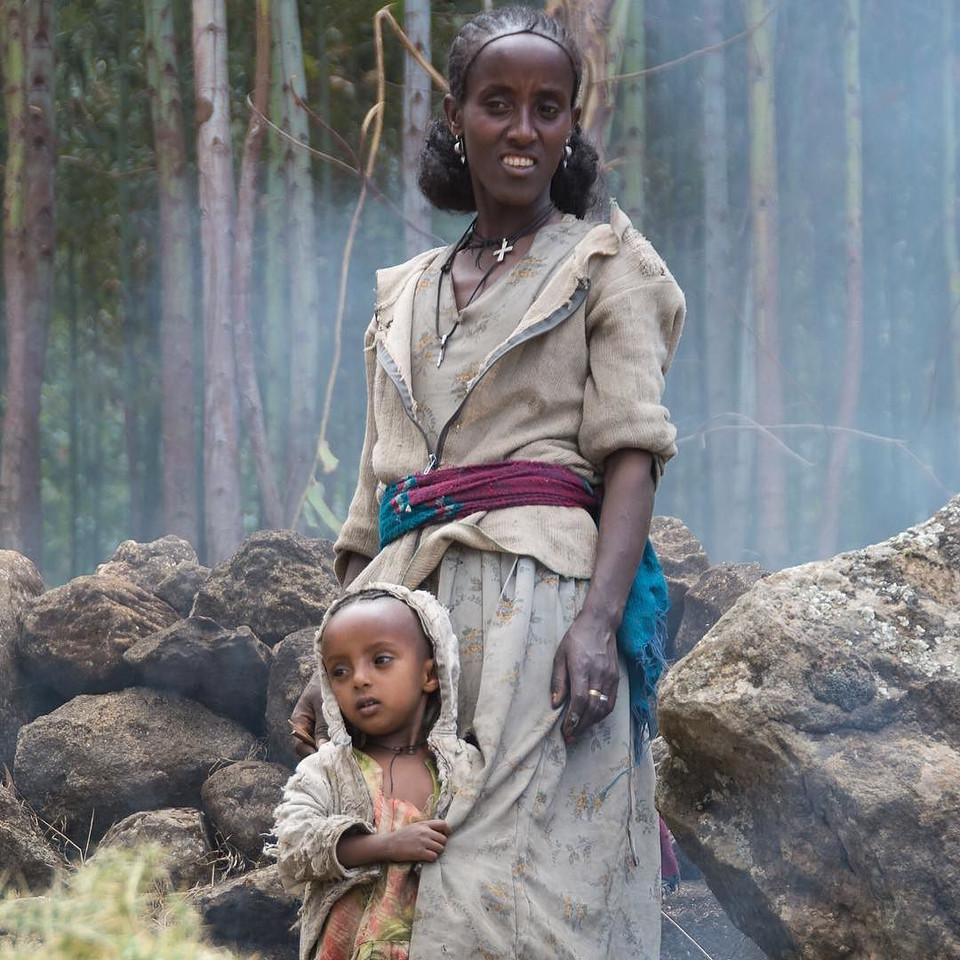 """""""Investing in Women: A Traveler's Perspective"""" is up on the blog (link in profile). The article is my $0.02 on the meaning and imperative behind and beyond International Women's Day. The image is one I took of a mother and daughter outside of Lalibela, Ethiopia. Mom takes a break from helping the entire village prepare for a 500-person wedding the following day. It's one of the lead images from Planet Her, a photo exhibit we are co-hosting this week in Berlin. Background on the exhibit is in the blog post and my previous IG post. via Instagram http://ift.tt/1R5wp5A"""