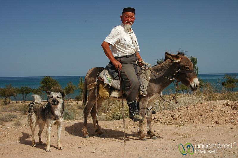 Kyrgyz Man and Dog - Lake Issyk-Kul, Kyrgyzstan