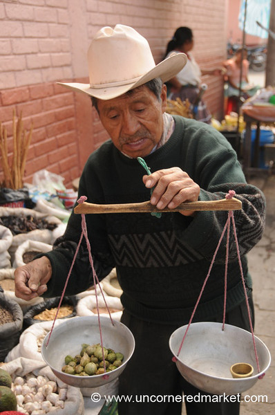Man Weighing Pepian Ingredients- Xela, Guatemala