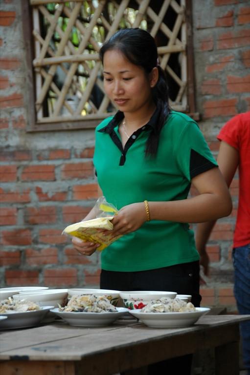 Bride Looking at Food - Battambang, Cambodia