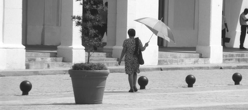 Woman with Umbrella - Havana, Cuba