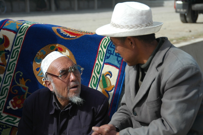 Men Talking Seriously - Xiahe, China