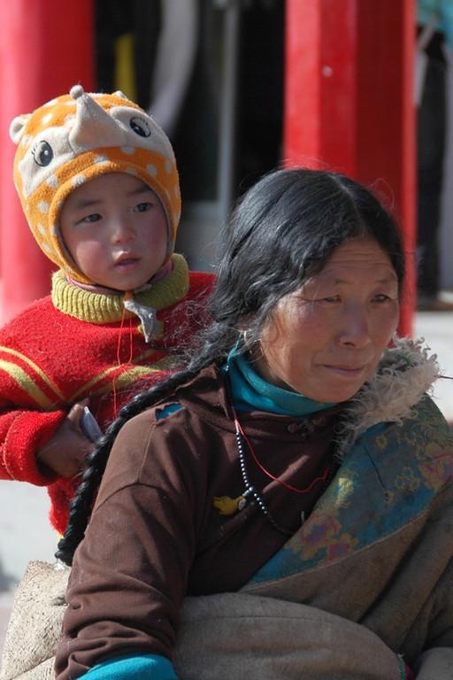 Tibetan Kid with Mother - Xiahe, China
