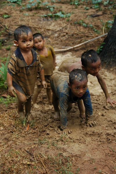 Children Walking Up the Muddy Hill - Battambang, Cambodia