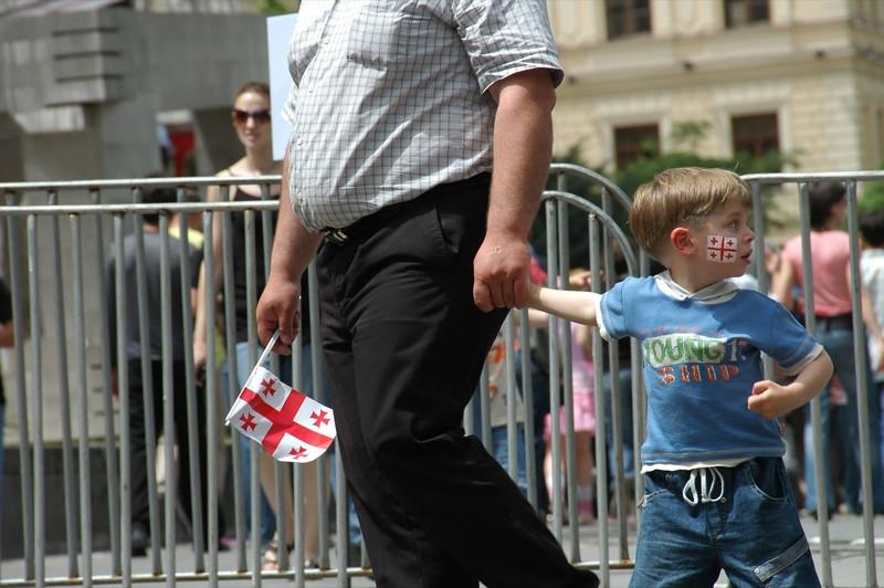 Father and Son at Parade - Tbilisi, Georgia