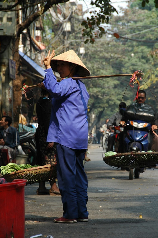 Street Vendor Waving - Hanoi, Vietnam