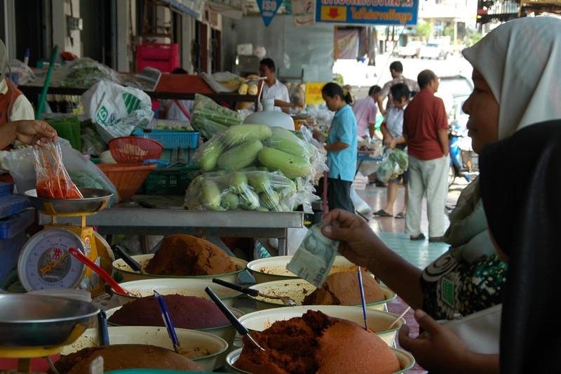 Woman Buying Curry Paste - Krabi, Thailand