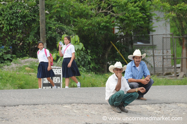 Honduran Men Waiting by Roadside - Copan Ruinas, Honduras