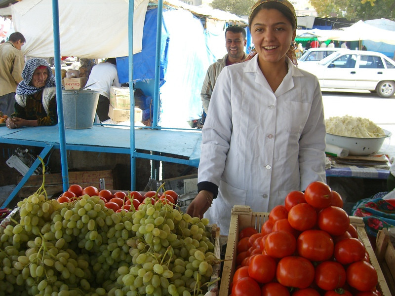 Smiling Woman Vendor at Varzob Market - Dushanbe, Tajikistan
