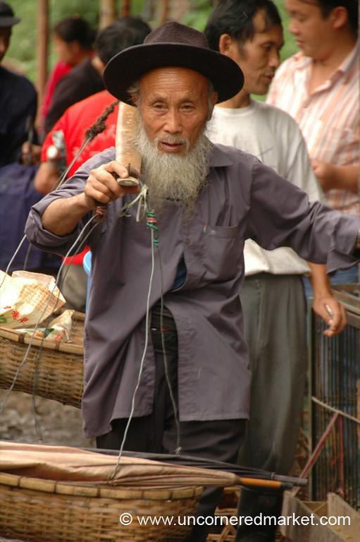 Old Man Balancing Goods at Market - Guizhou Province, China