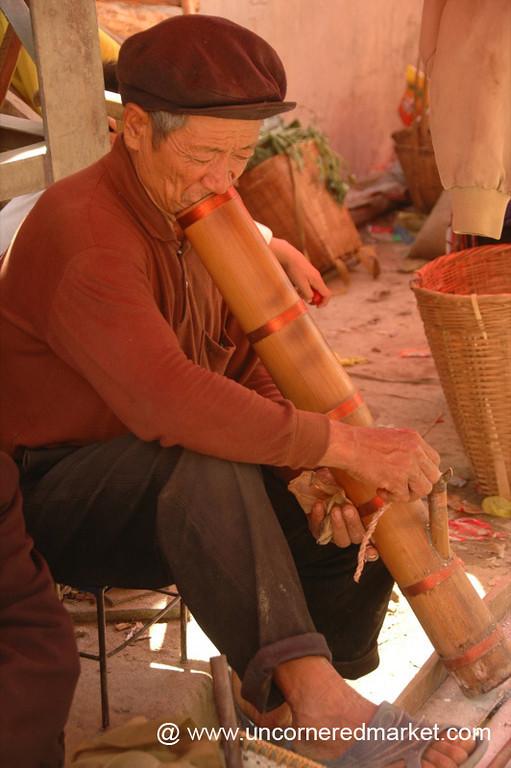Elderly Hani Man Smokes a Pipe - Yuanyang, China