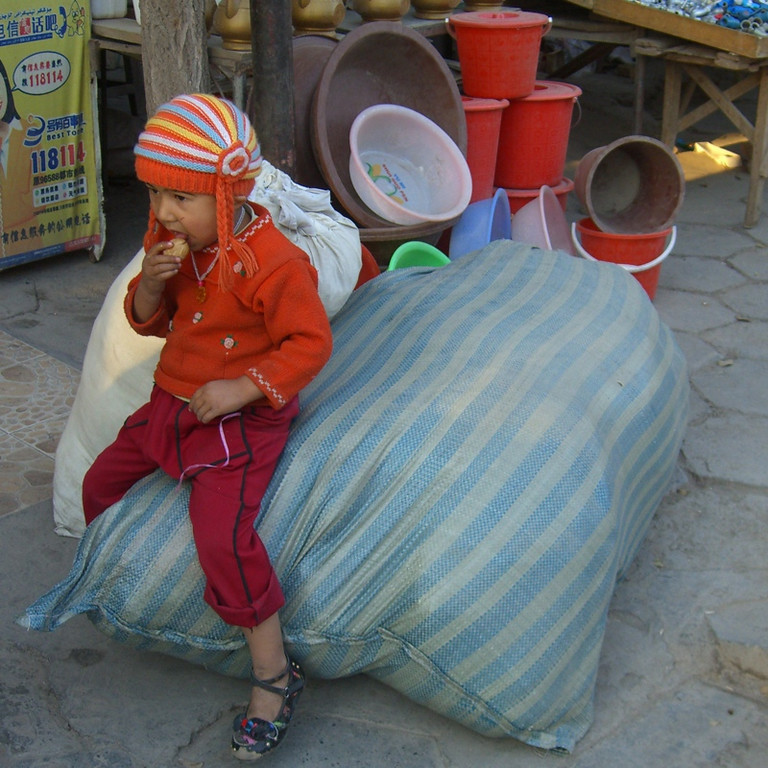 Xinjiang Child at Market - Kashgar, China