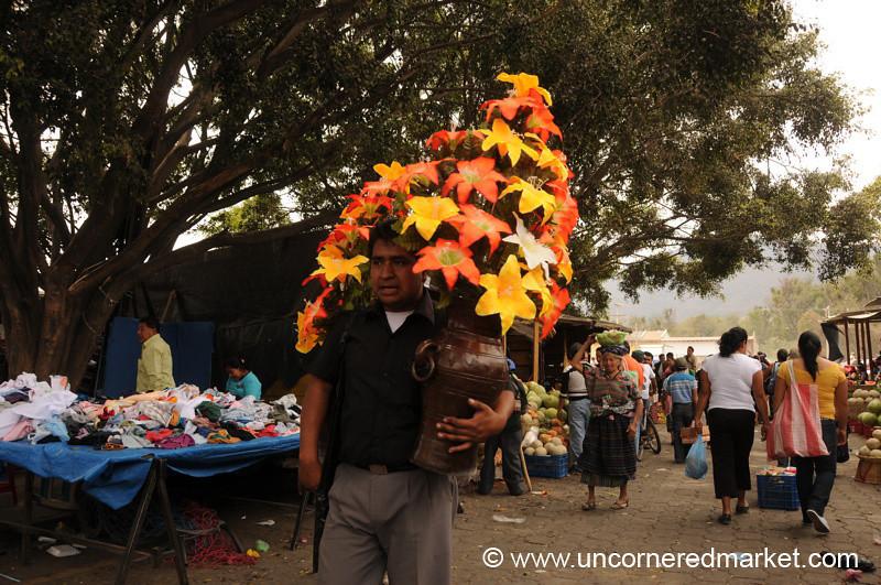 Man Holding Flowers - Antigua, Guatemala