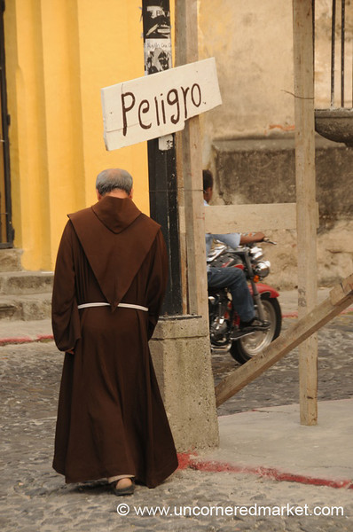 Monk Under Danger Sign - Antigua, Guatemala