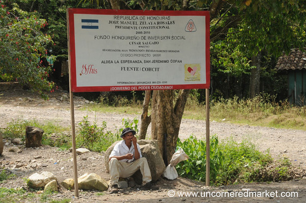 Man Below a Billboard - Copan Ruinas, Honduras