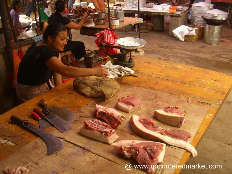 Pig Vendor - Xishuangbanna, China
