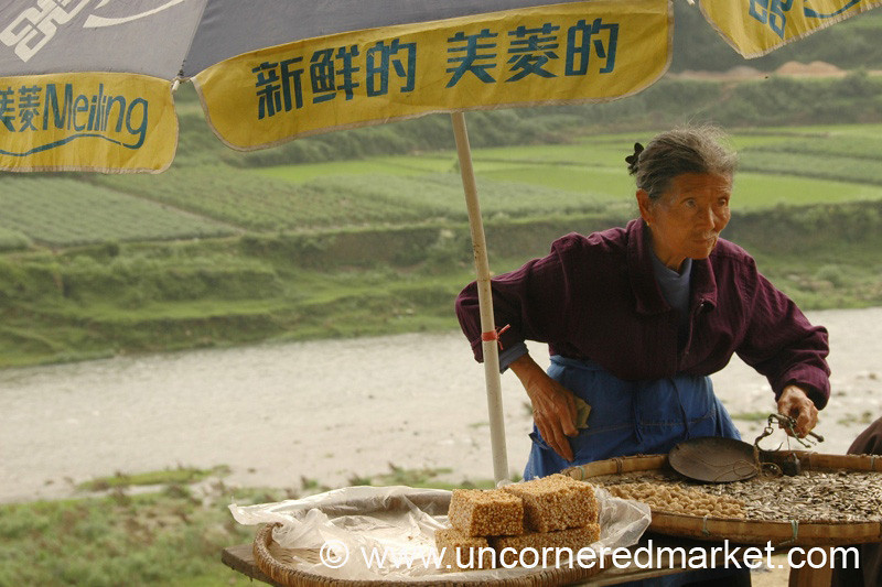 Woman Selling Nutty Snacks - Guizhou Province, China