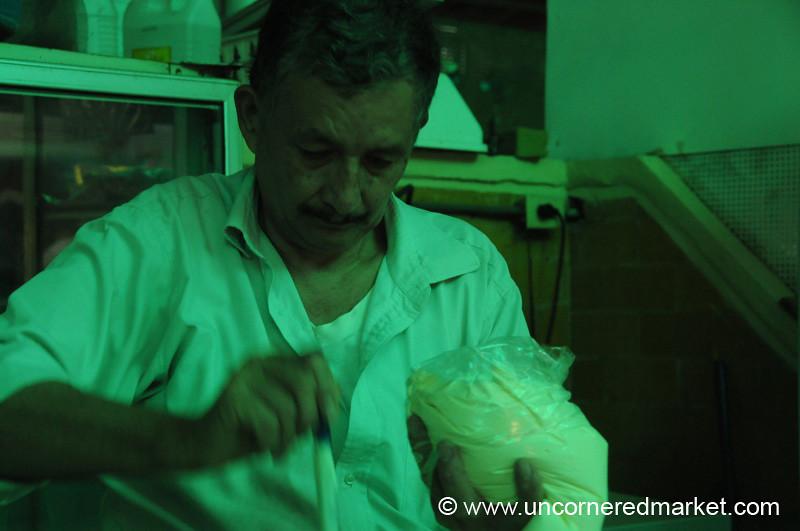 Man Scooping Sour Cream - San Pedro Sula, Honduras