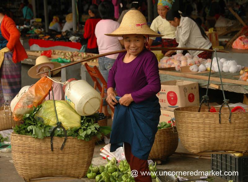 Woman Vendor with Baskets - Xishuangbanna, China