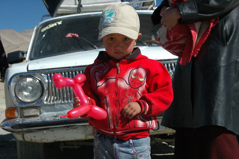Kyrgyz Boy with Animal Balloon - Osh to Murgab, Tajikistan
