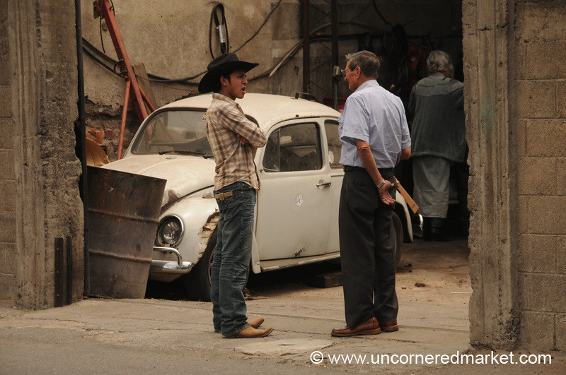 Men Talking and Volkswagen Beetle - Antigua, Guatemala