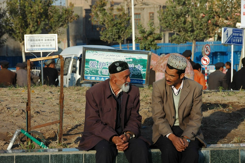 Uighur Men Talking - Kashgar, China