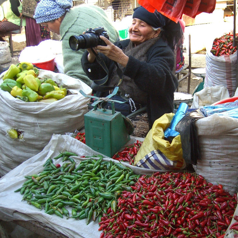 Pepper Vendor Looking at Her Image - Osh, Kyrgyzstan