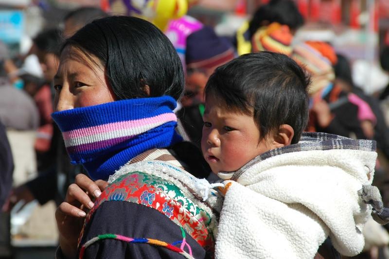 Tibetan Baby on Mother's Back - Xiahe, China
