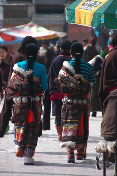 Tibetan Women Walking Down Street - Xiahe, China