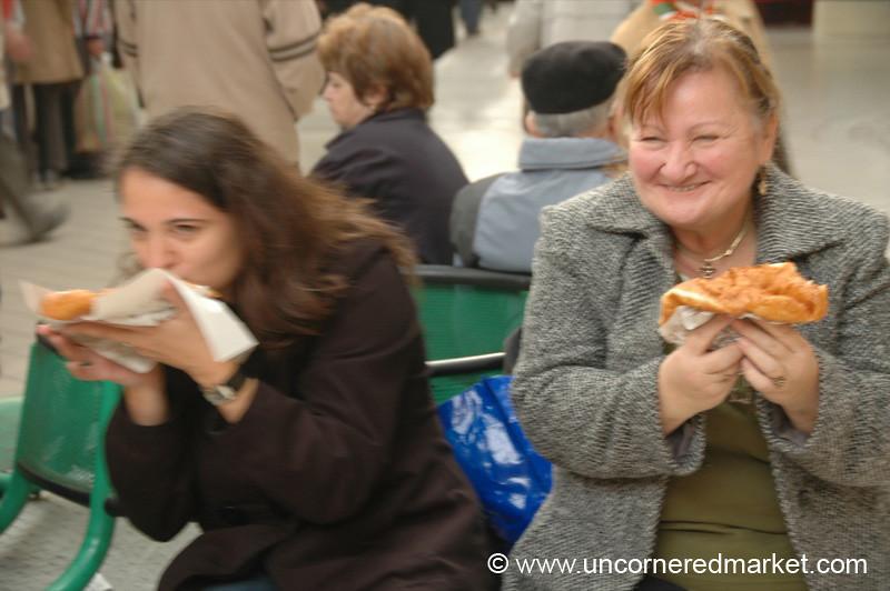 Women Laughing, Eating Langos - Budapest, Hungary
