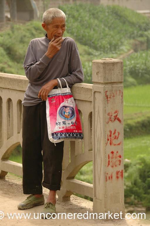 Elderly Man Taking a Break - Guizhou Province, China
