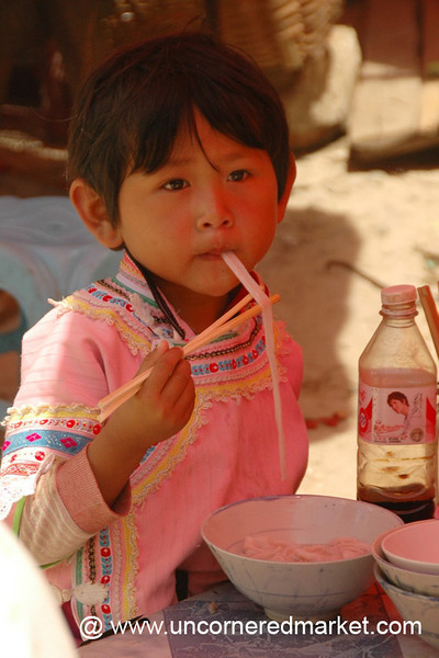 Hani Girl Eating Noodles - Yuanyang, China