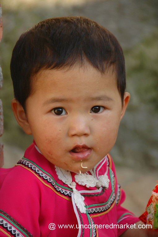 Little Girl Eating Snacks - Yuanyang, China