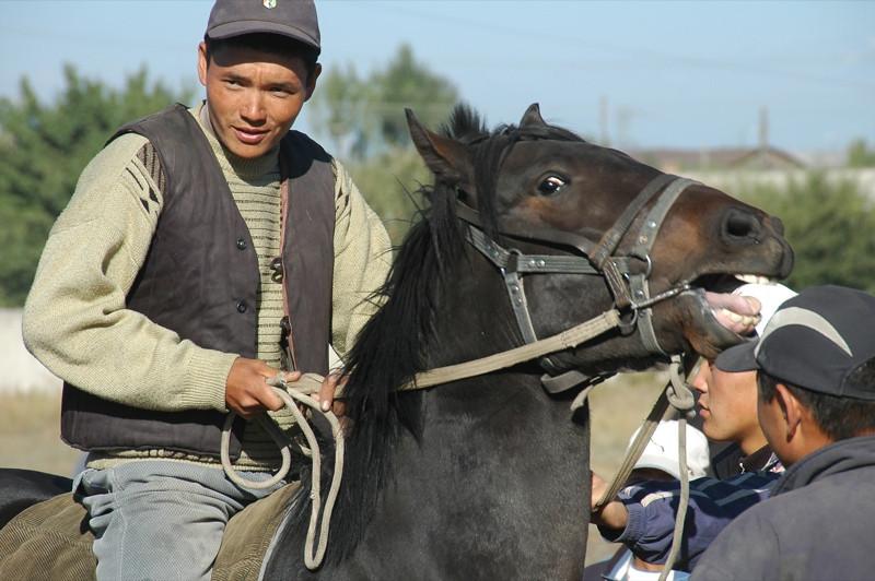 Kyrgyz Man on a Horse - Karakol, Kyrgyzstan