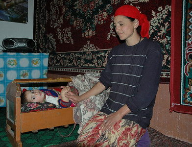 Pamiri Baby in a Crib - Langar, Tajikistan