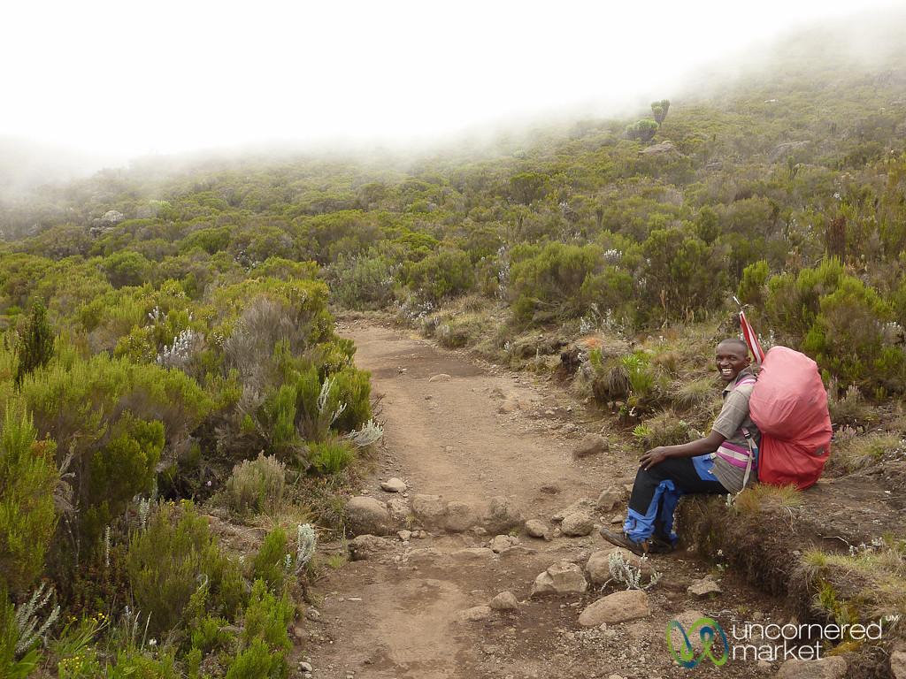 Asst . Porter takes a break - Kilimanjaro, Tanzania