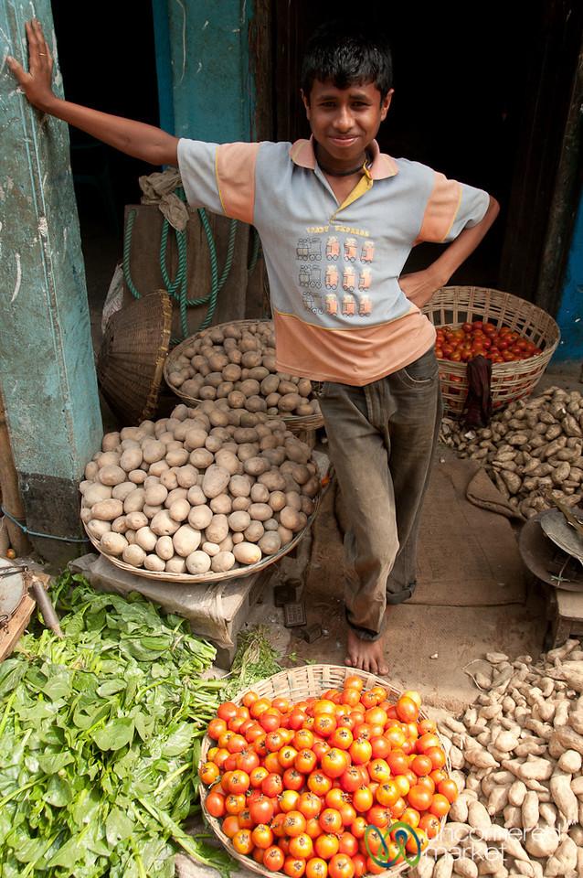 Vendor Standing Over Vegetables - Srimongal Market, Bangladesh