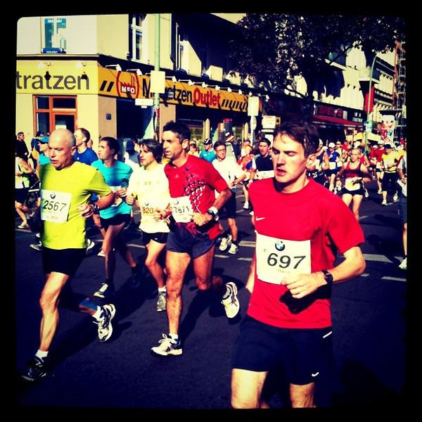 Berlin marathon running down Kottbusser Damm. Great runners, great crowd.