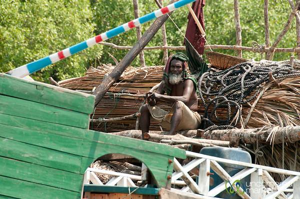 Older Man Sits on Boat - Sundarbans, Bangladesh
